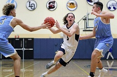 PAMPLIN MEDIA GROUP PHOTO: MILES VANCE - Canby's Nate McDonald drives to the basket during his team's 52-34 loss to Lakeridge at Canby High School on Friday.