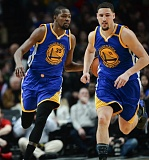 TRIBUNE PHOTO: JOSH KULLA - Kevin Durant (left) and Klay Thompson of the Golden State Warriors head up the court on Sunday at Moda Center.