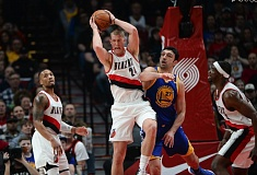 TRIBUNE PHOTO: JOSH KULLA - Trail Blazers center Mason Plumlee pulls down a rebound during Sunday night's home game against Golden State.