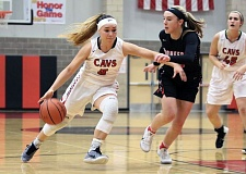 REVIEW/NEWS PHOTO: JIM BESEDA - Clackamas' Madeline Oakden, getting pressured by Oregon City's Brooke Bullock, had nine points in Wednesday's 62-60 victory over the Pioneers at Clackamas High School on Friday.