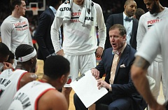 TRIBUNE PHOTO: JOSH KULLA - Trail Blazers coach Terry Stotts talks to his team during a timeout Sunday night against Golden State. Portland has been on an upswing, but needs to pick up its winning pace to make the NBA playoffs.
