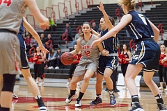 PHOTO CREDIT: TREVIS FONG - Pacific's junior guard Lauren Lykins dribbles into the key during the Boxers' game versus George Fox.