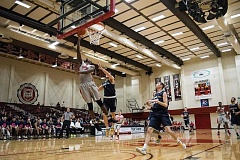 PHOTO CREDIT: TANNER BOYLE PHOTOGRAPHY - Pacific's J.B. Ewell goes up for a lay-up during the Boxers' game versus George Fox.