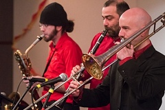 TRIBUNE PHOTO: JOSH KULLA - Members of the band Chervona perform last week at a celebration of Slavic culture that included music, food and representatives of various community groups centered around Portlands fast-growing Slavic population.