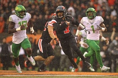 TRIBUNE FILE PHOTO: JAIME VALDEZ - Quarterback Marcus McMaryion of Oregon State runs past Orego Ducks Jimmie Swain (left) and Arrion Springs during the Beavers' Civil War victory last season in Corvallis.