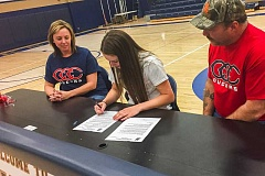 COURTESY PHOTO - Banks' Katie Ragsdale signs her letter of intent Sunday evening at Banks High School.