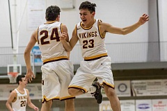 NEWS-TIMES PHOTO: CHASE ALLGOOD - Forest Grove's Guy Littlefield and Drake Littlefield celebrate as the Vikings take the lead in the final minute of their 70-67 win over McNary Tuesday 01-31-17.