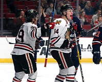 TRIBUNE PHOTO: JONATHAN HOUSE - Jake Gricius (right) celebrates a Portland Winterhawks goal with Colton Veloso on Wednesday night.