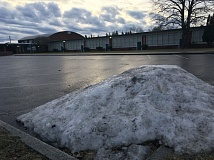 OUTLOOK PHOTO: JOSH KULLA - Ice coveres the parking lot at East Gresham Elementary School on Friday, Feb. 3.