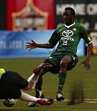 TRIBUNE FILE PHOTO: L.E. BASKOW - Lawrence Olum, in a 2008 Portland Timbers game against Puerto Rico, tries to get the ball past the goalkeeper.