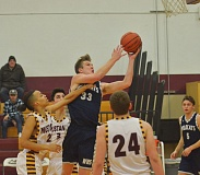 SPOKESMAN BY COREY BUCHANAN - Wilsonville's Zach Reichle set the court on fire during a Jan. 31 game against Milwaukie, scoring a record-breaking 52 points.