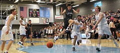 REVIEW PHOTO: MILES VANCE - Lake Oswego guard Daniel Baumer loses the ball on a drive during his team's 67-65 overtime win over Lakeridge at Lakeridge High School on Friday.