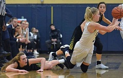 HERALD PHOTO: COREY BUCHANAN - Canby guard Hannah Myers passes to a teammate after a tussle for the ball late in the second half of her team's Friday home win over West Linn.