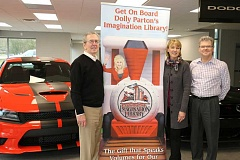 SUBMITTED PHOTO - From left to right: Jack Grimley, Findlay general manager, Jan Rippey, founder of Dolly Partons Imagination Library (DPIL) in Wilsonville, and Patrick Duke, Wilsonville library director all gathered to set up a station within the Findlay dealership for children within the community to sign up to be a park of DPIL.
