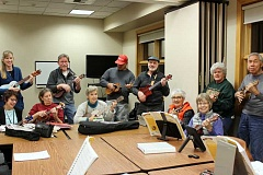SPOKESMAN PHOTO: CLAIRE GREEN - Ten to 20 people show up to the Wilsonville Community Center Wednesday nights to play a selection of ukulele classics and modern adaptations.