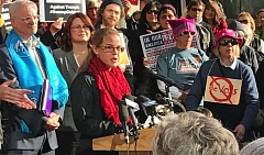 PHOTO BY DANA HAYNES - Sara Schmitt of the Beaverton Education Association was among the speakers at a press conference Feb. 27, in opposition to the DeVos nomination. Behind her, in blue scarf, is Congressman Earl Blumenauer. An estimated 300 people attended the press event.