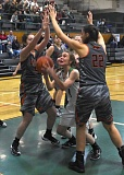 ESTACADA NEWS: HEATHER TREANOR - Estacadas Karlye Nakashimada tries to find her way to the basket amidst a crowd of defenders during last weeks 40-31 loss to Gladstone.