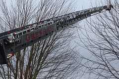 OUTLOOK PHOTO: ZANE SPARLING - A Gresham Fire ladder extends over Camping World in Wood Village on Thursday, Feb. 2.