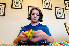 NEWS-TIMES PHOTO: CHASE ALLGOOD - Gaston High School student Ben Gottschalk holds top rankings in some Rubik's Cube competitions and can solve some cubes in three seconds.
