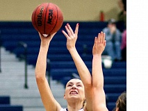 SETH GORDON - Center Kaitlin Jamieson takes a shot during George Fox's 78-51 victory over Pacific Lutheran Saturday evening at Miller Gymnasium. Jamieson posted game highs in points (23), rebounds (10) and blocks (five).