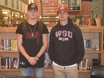 SPOKESMAN PHOTO: COREY BUCHANAN - Wilsonville quarterback Connor Neville (right) signed his letter of intent to play football for Washington State University while Jonny Neville accepted prefereed walk-on status to WSU.