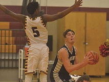 SPOKESMAN PHOTO: COREY BUCHANAN - Wilsonville senior wing Zac Woodworth scored 13 points against Putnam and accumulated 11 rebounds against Hillsboro.