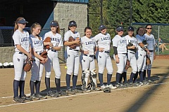 SUBMITTED PHOTO: SHELLY JONES - Lake Oswego High School's softball team lines up in April 2016 during a home game against North Salem on the dirt field at Lake Oswego Junior High School.