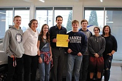 NEWS-TIMES PHOTO: STEPHANIE HAUGEN - (Left to right) Zach Streblow, Sydney Gregg, Hannah White, Max Merritt, Trevor Thiessen, Bennett Turner and Banks Parent Association President Melissa Merritt thanked Michael Doherty (center with sign) for a successful fundraiser.
