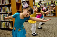 REVIEW PHOTO: VERN UYETAKE - Avery Neice and her fellow students at the Chinese American International School perform a dance about dolls and bears Saturday during a Year of the Rooster celebration at the Lake Oswego Public Library.
