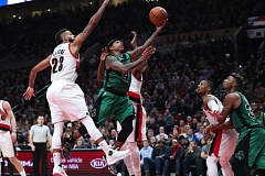 TRIBUNE PHOTO: JAIME VALDEZ - Boston Celtics guard Isaiah Thomas splits the Blazers defense for two of his game-high 33 points.