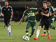 TRIBUNE PHOTO: JOSH KULLA - Diego Chara tries to push forward for the Portland Timbers on Sunday.