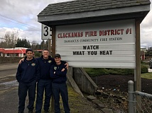 SUBMITTED PHOTO - Pictured at Clackamas Fire's new sign at Damascus Station 19 are (from left) firefighter Justin Lynn, Capt. Josh Gehrke and apparatus operator Blake Meyer.