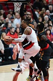 TRIBUNE PHOTO: JOSH KULLA - Blazers guard Damian Lillard tries for a reverse layup against the Atlanta Hawks on Monday night at Moda Center.