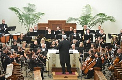 SUBMITTED PHOTO - Mark Perlman, conductor, leads the Willamette Falls Symphony in concert at Mt. Angel in November 2014. The symphony's concert on Feb. 19 in Oregon City features Gustav Holst's 'The Planets.'