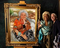 SUBMITTED PHOTO - Robin Damore (far right) poses with Nichelle Nichols, of 'Star Trek' fame, alongside a painting of Nichols that resulted from a meeting of the women several years ago in Los Angeles.