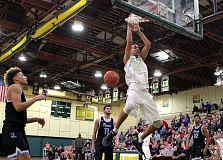 PMG PHOTO: MILES VANCER - West Linn's Khalid Thomas follows through after throwing down a dunk during his team's 92-74 win over Lakeridge on Tuesday at West Linn High School.