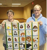 SUSAN MATHENY/MADRAS PIONEER - Country Quilters members MaryJo Jones, left, and Shawn Winsor show the baby quilt Jones is working to complete to exhibit in the April show at the fairgrounds.