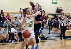 TIDINGS PHOTO: MILES VANCE - West Linn's Adina Mollusky gets fouled by Lakeridge's Laura Barton during West Linn's 74-33 win over Lakeridge on Tuesday at West Linn High School. TIDINGS PHOTO: MILES VANCE