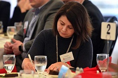 REVIEW PHOTO: VERN UYETAKE - Foundation board member Lara James fills out a donation form at the Jan. 31 fundraiser luncheon.