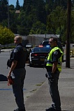 SPOTLIGHT FILE PHOTO - Scappoose Police Sgt. Dennis Viereck and Officer Matt Dorick work the scene of an incident in 2016. Scappoose Police Department, like other local law enforcement agencies, does not check for citizenship status in its routine duties.