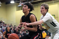 PMG PHOTO: MILES VANCE - Clackamas' Cole Turner (left) and the Cavaliers moved up to No. 3 in the OSAA's latest Class 6A boys basketball power rankings, trailing only Jefferson and West Linn.
