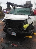 PHOTO COURTESY: CLACKAMAS FIRE - A man was pinned in this full-size van after it crashed at the intersection of 242nd Avenue and Hoffmeister Road