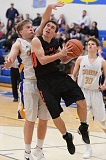 PAMPLIN MEDIA GROUP PHOTO: LON AUSTIN  - Molalla sophomore Jeff Larsen goes up past Crook County's Will Combee.