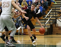 REVIEW/NEWS PHOTO: JIM BESEDA - North Clackamas Christian's Lane Ehigh scored a team-high 12 points in Thursday's 39-36 loss to Damascus Christian at Multnomah University.