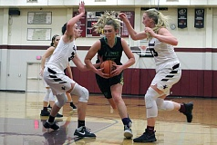 TIDINGS PHOTO: MILES VANCE - West Linn's Kennedy Fulcher drives through the key during her team's 26-23 win at Sherwood High School on Friday night.