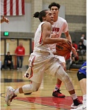 REVIEW/NEWS PHOTO: JIM BESEDA - Clackamas' Elijah Gonzales drives to the basket during the first half of Friday's Mt. Hood Confrence home game against Barlow.