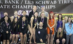 PMG PHOTO: MILES VANCE - The Sunset girls 200-yard freestyle relay team (center, behind coach Adam Farber) helped the Apollos win the Class 6A state championship on Saturday at Mt. Hood Community College Aquatic Center.