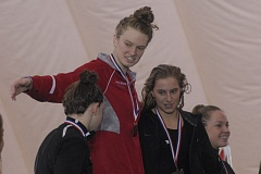GRESHAM OUTLOOK: MATT RAWLINGS - Jamie Stone (middle) atop the podium after winning the girls 50-yard freestyle