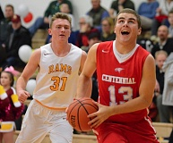 OUTLOOK PHOTO: DAVID BALL - Centennials Dawson Day breaks to the basket past Central Catholics Connor Standring to score a layup in the second half of Fridays 52-46 road loss.