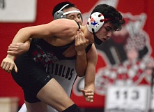OUTLOOK PHOTO: DAVID BALL - Dillon Nunes of David Douglas works for an escape during his 4-3 win over Reynolds Daniel Nguyen in the 120-pound championship bout Saturday.